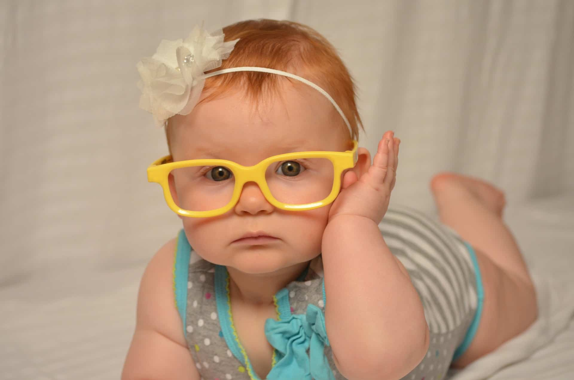 girl wearing yellow baby glasses and turban